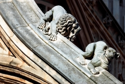 Medieval lion and dog whizzing down a flying buttress on Westminster Abbey.